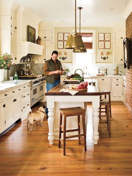 Whitewashed cabinets, marble countertops, and a large island make this southern kitchen functional and charming... (Photo: Laurey W. Glenn): Farms Houses, Kitchens Design, Butcher Blocks, Brick Wall, Kitchens Ideas, Kitchens Islands, Farmhouse Kitchens, White Cabinets, White Kitchens