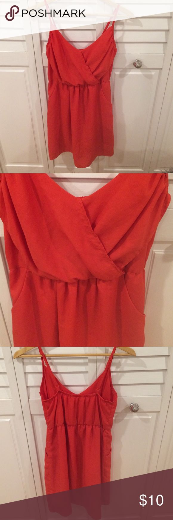 Reddish orange short casual dress Lush brand reddish orange dress. Light material, with pockets, perfect for warm weather. Draped chest detail is very flattering. Size XS. Lush Dresses
