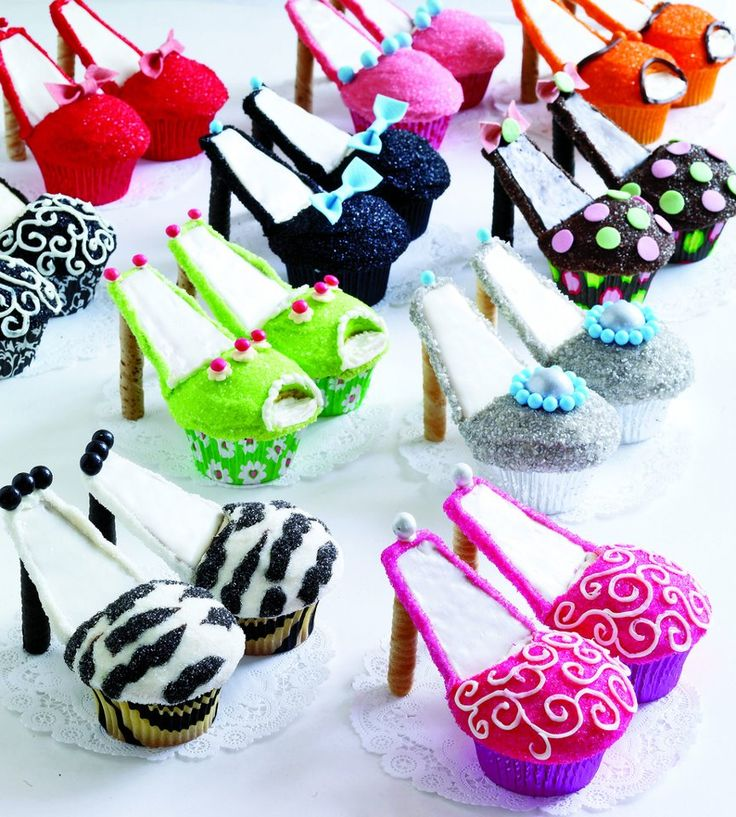 Cupcake shoes. The pin takes you only to the photo. I was thinking this would not be that difficult. You take a reguar cupcake and cut a slit in part of the end at a diagonal off the top circle part. The you take a ice cream cone cupcake an cut it in half fitting it into the spot upwards. You then fronst them in the colors you want and dust then with colored sugar and decorate with drawing icing. For the heel you insert on of those Pirhoutte cookies or a round tall cookie like they have from…