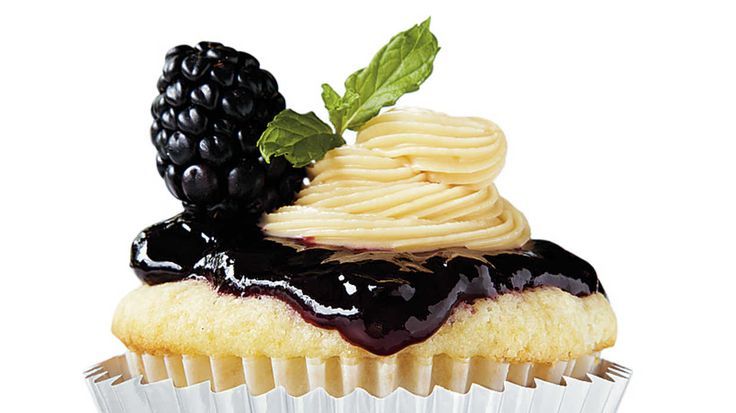 Vanderbilt: The Tennessee Jam Session - College Football Cupcakes - Southern Living - Inspiration: Tennessee jam cake and the Music City  Melt 15 caramels with 1 Tbsp. milk; stir into frosting. Spread blackberry jam onto cupcakes, pipe with frosting. Garnish with fresh blackberries and fresh mint sprigs.