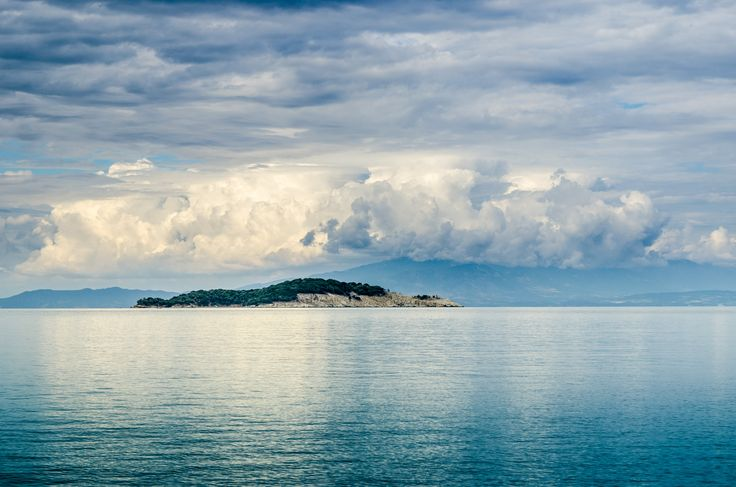 Kapros / Kafkanas island as viewed from Olympiada beach. Olympias, mother of Alexander the Great, was exiled here in 316 BC by her rival Cassander after Alexander's death. Olympiada's name has its roots into this legend. #Greece #Halkidiki #Olympiada