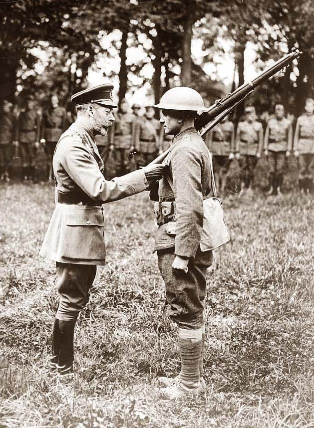 King George decorating men of the 33rd Division, August 12, 1918.