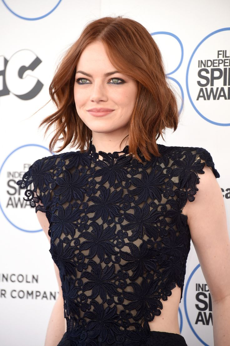 Emma Stone - hooded eyes makeup I love the smugy smokey navy blue eyeliner on her lower lids.