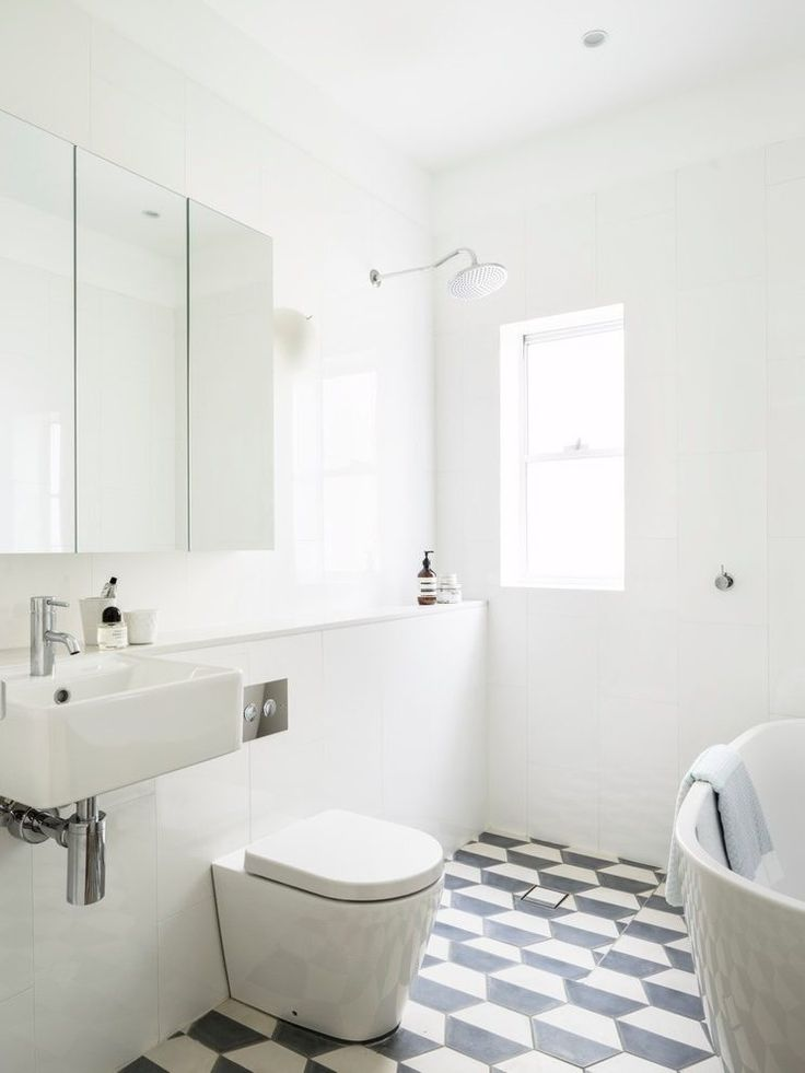 geometric trapezoid tile bathroom beach style with small shower mounted showerheads and body sprays