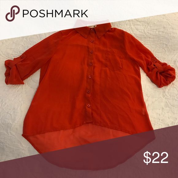 Orange flowing blouse This burnt orange, transparent blouse is great with a pair of jeans or dressed up with a camisole. Tops Blouses