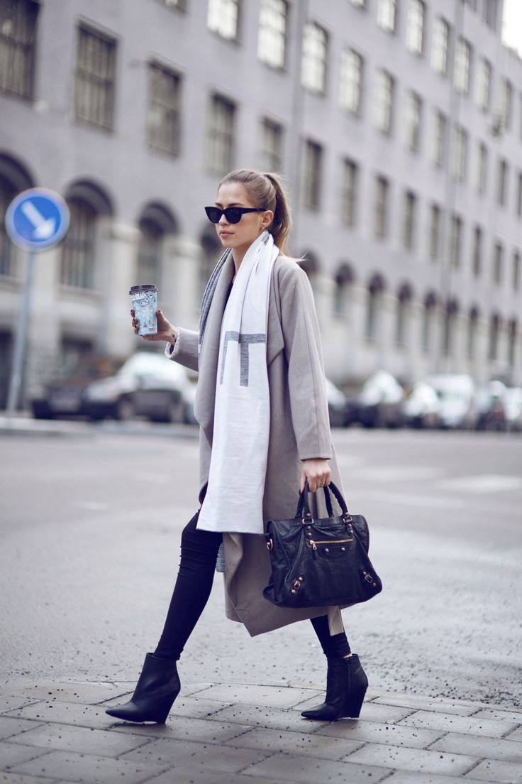 Street Style January 2015: Kenza Zouiten is wearing an oversized scarf from Ivy Revel, grey coat from Weekday, bag from Balenciaga, black jeans from Monki and the boots are from Jennie-Ellen
