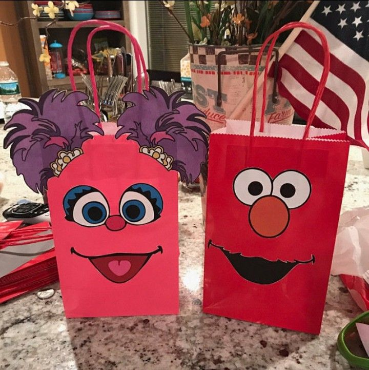 DIY Abby and Elmo treat bags assembled by one of our customers who bought our printables. Abby Cadabby Party Ideas/ decorations/ Abby Cadabby and Elmo Birthday Party theme/ Abby Cadabby and Elmo Party favor bags/ treat bags/ goody bags/ gift bags/ candy bags/ boxes/ DIY Elmo and Abby Cadabby Party Printables. Elmo and Abby Cadabby Birthday cake/ labels/ piñata/ party favors/ stickers