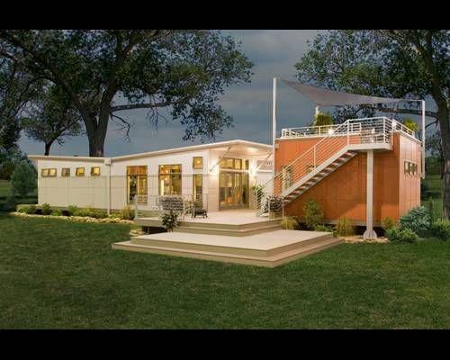 wit en oranje modulaire huizen met ramen en balkon