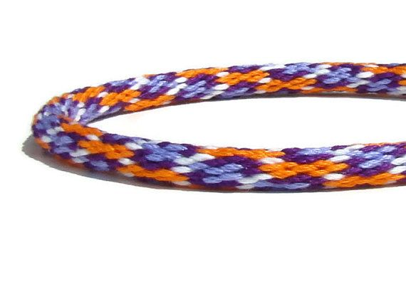 Woven in a fun new spot pattern, this kumihimo bracelet is a bright pop of color with two shades of purple, orange, and white. Sized to fit all ages. This bracelet is woven in the ancient Japanese art of kumihimo, using a round kumihimo loom. A thicker version of my classic braid,
