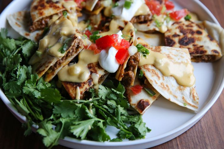 Beef Quesadillas with Queso Blanco Sauce.  might be pinning this just for the easy homemade queso recipe!