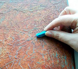 Once the paint is dry,  rub over the whole background with an oil pastel in a contrasting colour - this picks out all those gorgeous creases beautifully! You could also use coloured pencil or even a wax crayon for this step.
