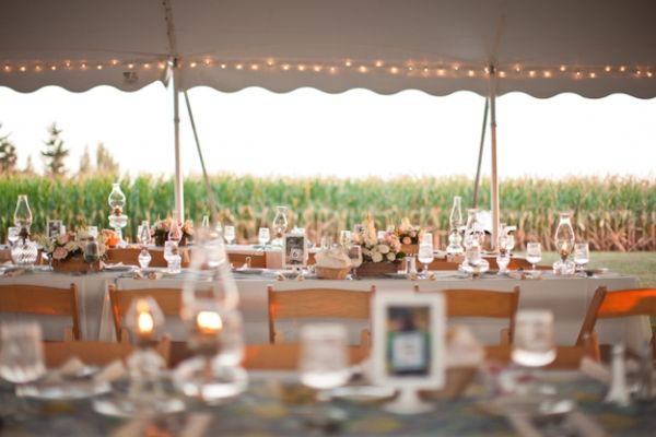 Open-sided marquees with long tables and fairy lights always look so inviting.