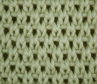 This site is cool, shows you how to knit different stitches, regardless of your pattern. This is the Eyelet Moss Stitch.