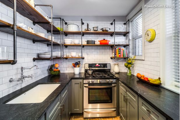 New This Week: 3 Modern Kitchens With Something Special | Houzz // Deep gray cabinets, a dark countertop and a rich brown stain on the open shelving against white subway tile give the space the appearance of being larger and brighter.