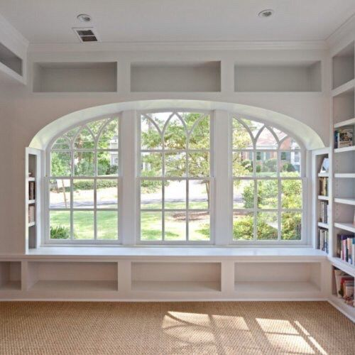 Window Seat With Storage Areas Underneath Bookshelves On The Sides