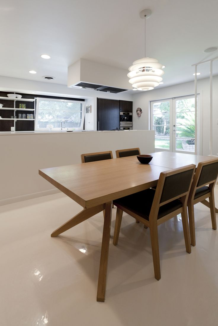 For his family's home in Sacramento, architectural designer Curtis Popp found the dining table, designed by Matthew Hilton, and the Italian chairs at a Design Within Reach warehouse sale. He bought the Henningsen PH Snowball lamp on eBay. Photo by Mike Graffigna