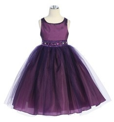 Flower girl dress, but it will be a darker plum with a black sash/belt with a broach on the side