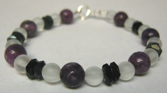 A.D.D. symptom relief bracelet:  Lepidolite (purple) promotes relaxation, calming an overactive mind.   Black tourmaline helps disengage from compulsive behaviors.  $25.95