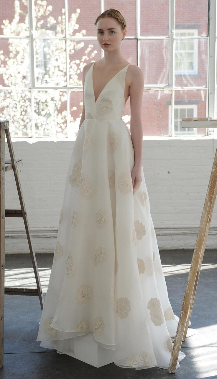 Plunging neckline with champagne appliqués wedding dress from Lela Rose Spring 2017