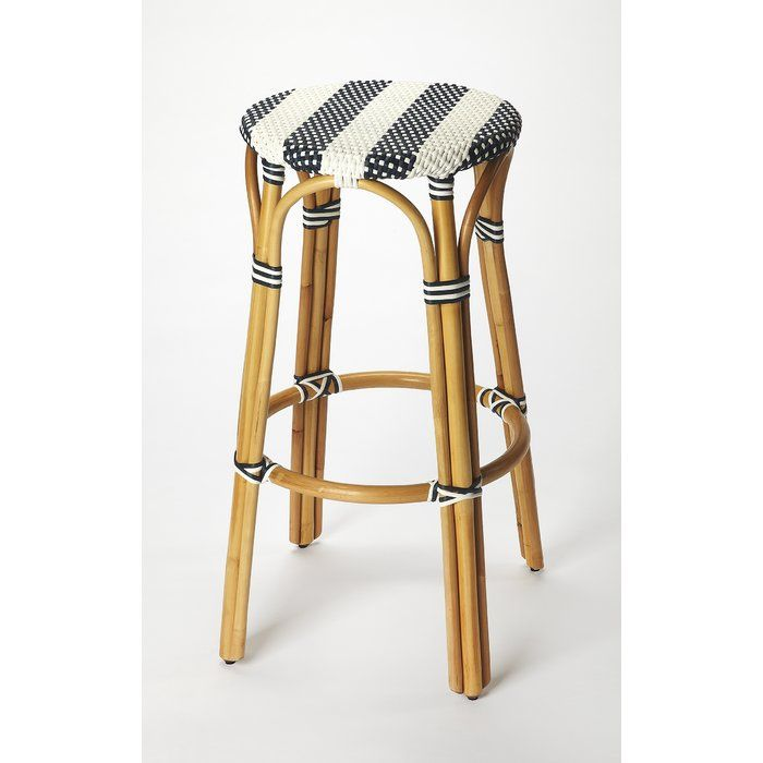 Evoking images of sidewalk tables, bar stools like this will give your kitchen or patio the casual sophistication of a Mediterranean coastal bistro. Skillfully crafted from thick bent rattan for superb durability, featuring a weather resistant woven plastic in blue and white. This bar stool is light weight of easy mobility with comfort to make the space it's in a frequent gathering place.