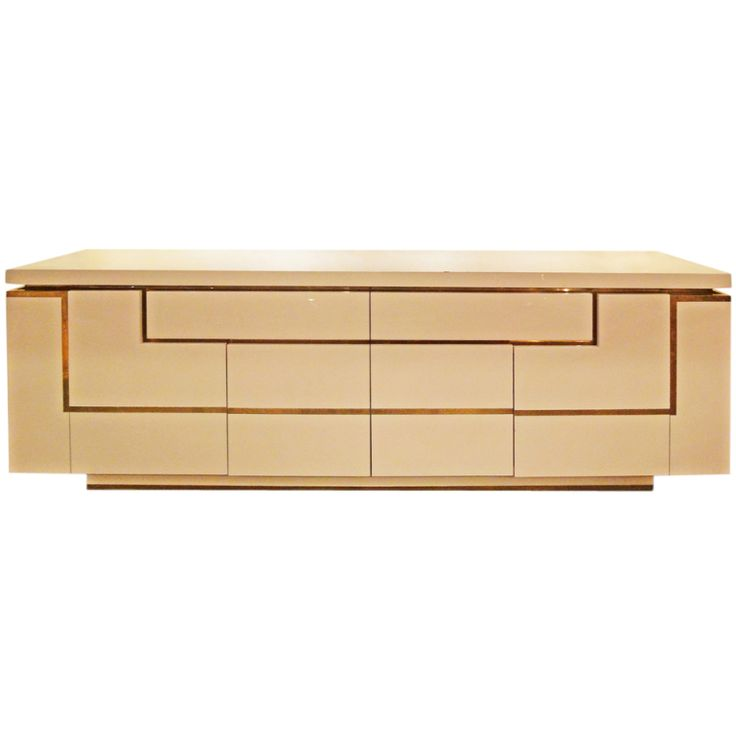A Large Sideboard by J.C. Mahey.  This is fabulous.  Love the architectural design and color.