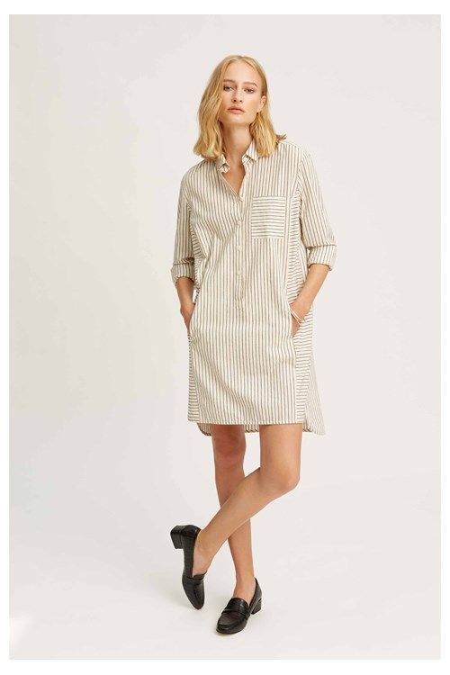 People Tree have reimagined the classic shirt dress this season by adding a touch of sophistication to the day wear staple. Made from a fluid organic cotton, this striped shirt is finished with a neat point collar and rounded hem for a streamlining effect. Wear yours over the tailored Cynthia trousers or a pair of thick tights.