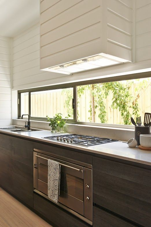 Contrasting textures add character to a space - Kitchen design by @hamlanhomes featured in the Bancoora Vista Display. Rich hues of natural elements illuminated by the narrow room length window. Statement piece - Caroma Liano Nexus sink mixer in black http://www.hamlan.com.au/our-homes/4123/Bancoora++Vista/ #Kitchen #Design #Interior #Styling #Trending #Window #WeeklyHomeTrends