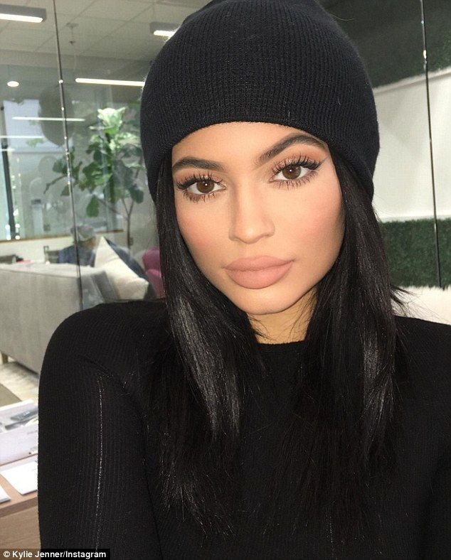 'Makeup by me': Jenner posted a snapshot to Instagram showing off her smokey matte eye and plumped up pout