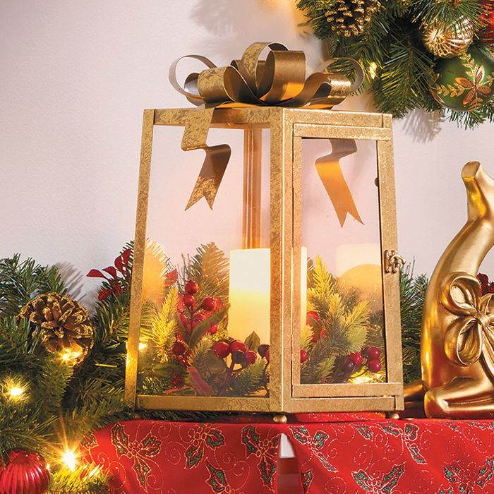 Lantern Christmas decoration is topped with a