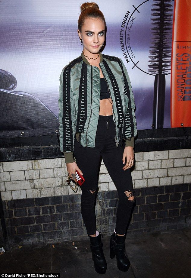 Casually chic: Cara Delevingne rocking a seriously stylish look as she arrived at the launch of her make-up collaboration with Rimmel on Wednesday