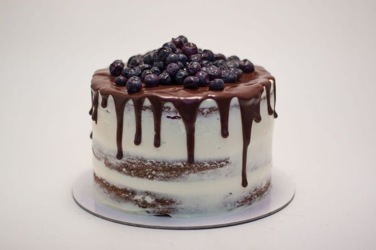dripping semi naked cake with blueberries
