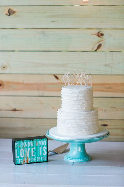 Simple, modern white wedding cake idea - two-tier white ruffle frosting wedding cake with laser-cut gold sparkly cake topper {Eileen K. Photography}