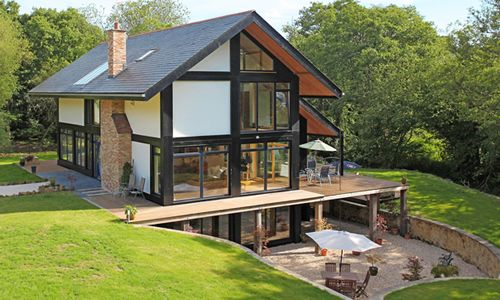 """Elfin Hollow (in Tunbridge Wells) uses """"insulated panels, under floor heating, solar panels to heat water, triple glazing, an air circulating system with heat exchange, and a rain harvester."""""""