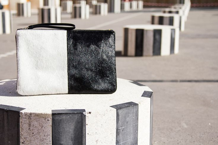 Modern Monochrome. Our Black and White Travel Clutch Lara is the modern way to colour block.  Shop this style at: www.jauntaccessories.com