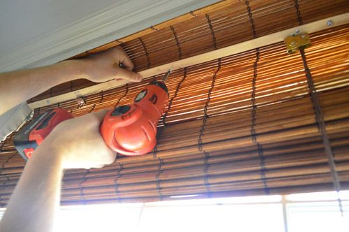 If you want a perfectly fitted INSIDE mount, use a needle nosed pllyers to remove the metal hanging rings off the top.  Then screw through the wooden brace piece at the top of the shade to secure them into the window trim