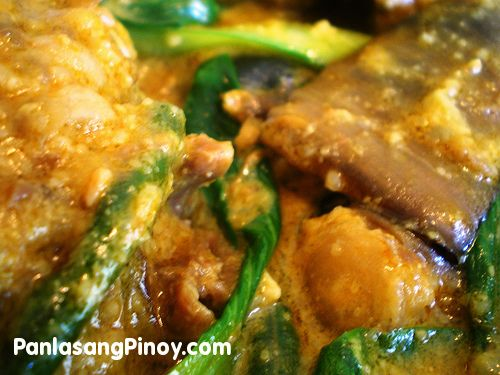 "Kare Kare is a traditional Filipino stew complimented with a thick savory peanut sauce. The commonly used meats for this dish are ox tail, tripe, and pork leg; on some occasions goat and chicken meat are also used. Besides the peanuts, this dish depends on the shrimp paste (on the side) in order to be fully enjoyed. Traditionally, ""palayok"" (cl"