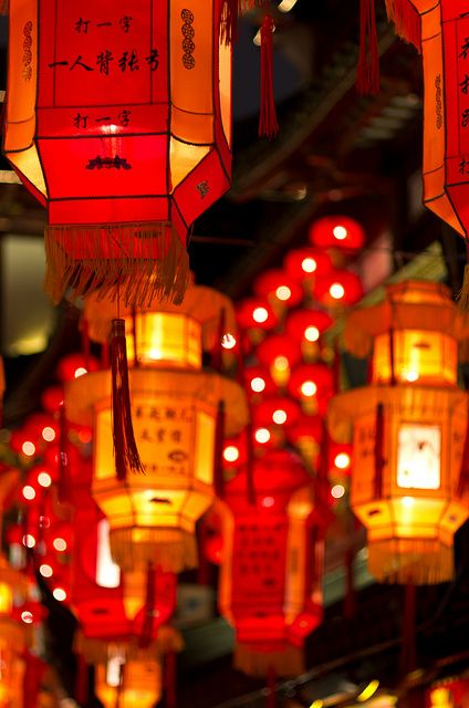 Traditional Red Chinese Lanterns light the streets of Shanghai during the annual Lantern Festival.   Photo by Yves Andres.