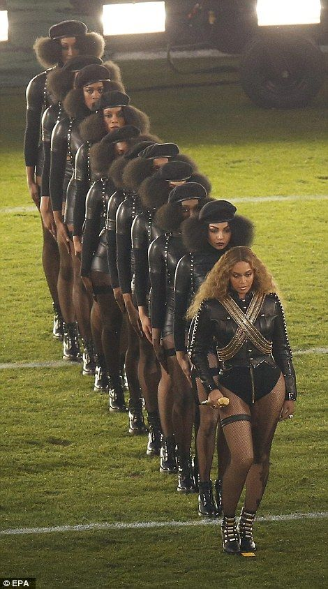 Disiplined: Beyonce walked on to the field with the performers in a straight line like a m...