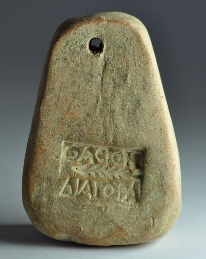 Greek inscribed loom weight, 4th century B.C. With palmette and greek inscription DIAGORA. Private collection