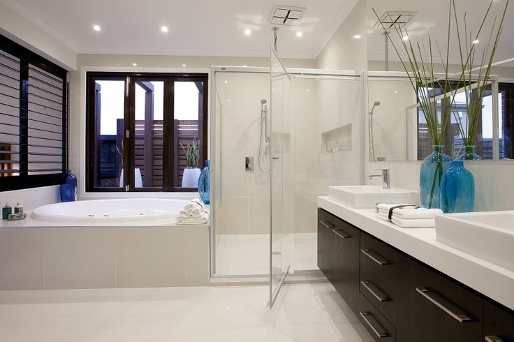 Escape to this luxurious double ensuite with its beach Californian style. A large spa bath is neatly tucked away giving the bathroom space and gorgeous blue hues are splashed throughout in glassware.