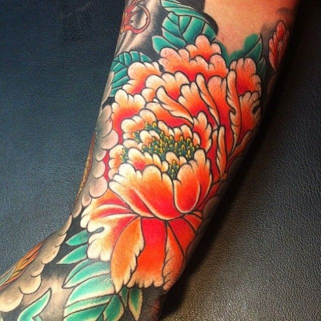 beautiful orange flower tattoo