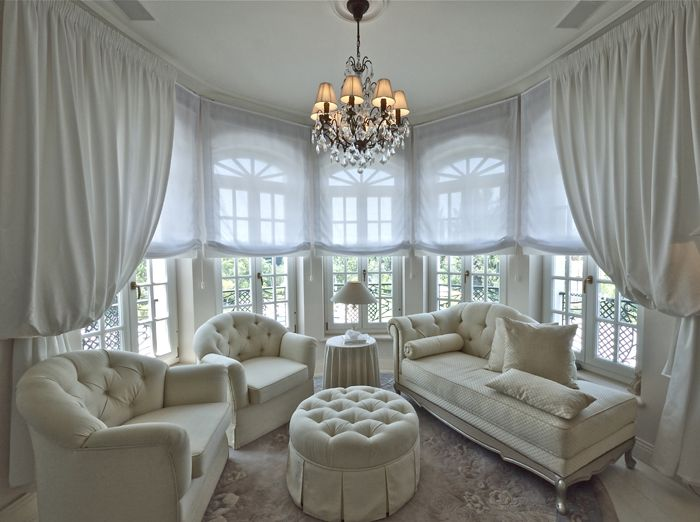 A dining room in a #bowwindow