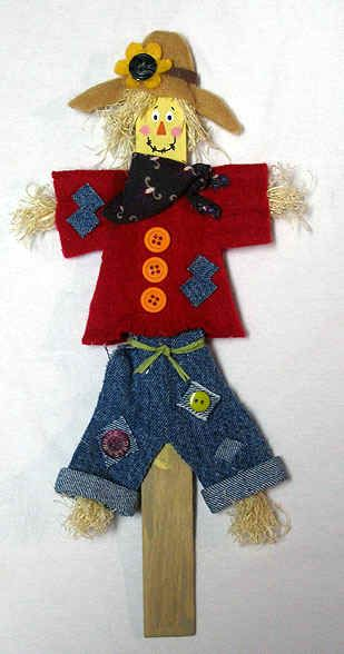 Free Halloween craft projects and costume   ideas at Craftown. This one is for an easy to make, paint stick scarecrow.   Free patterns and projects for year round crafting. Fun for kids of all ages.