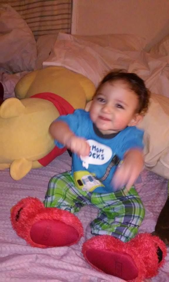 Angelo wearing his Elmo Slippers!