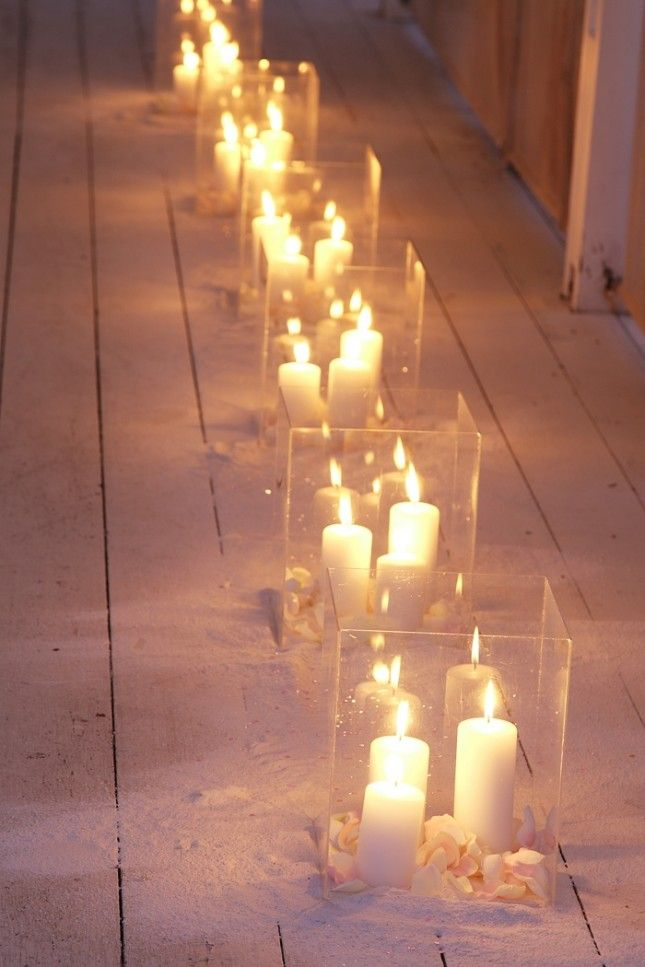 Use large pillar candles in hurricane vases to light up your wedding.