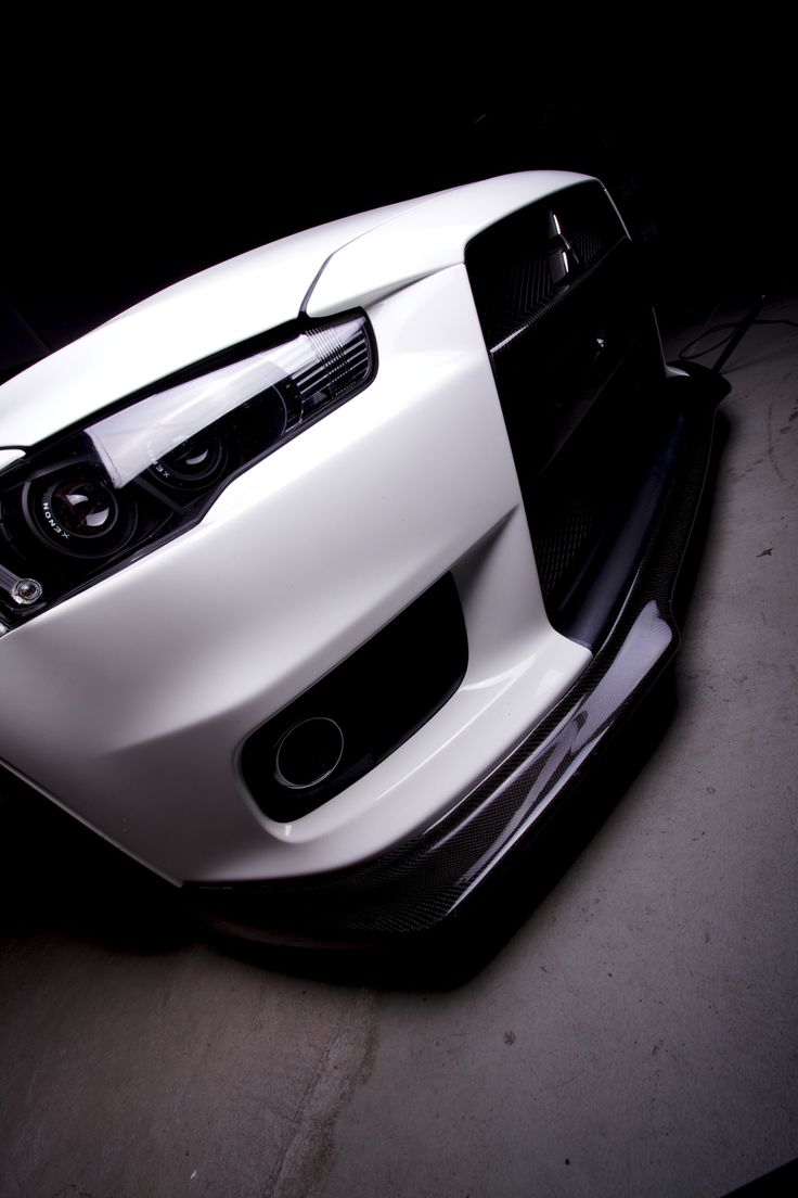 Evo X front end with baked and painted black projector headlights, looks great