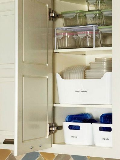 """Use plastic bins (Dollar Store) to organize tupperware and storage cntainers. SO MUCH BETTER THAN MY CURRENT SYSTEM (aka """"throw it all in the bottom cabinet and try to avoid it then get really mad when you can't find the right size container or a matching lid so you buy new ones at the next Target run."""")"""