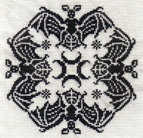 Bats biscornu - find the free chart here:  http://myauntsattic.weblog.nl/geen-categorie/terug/