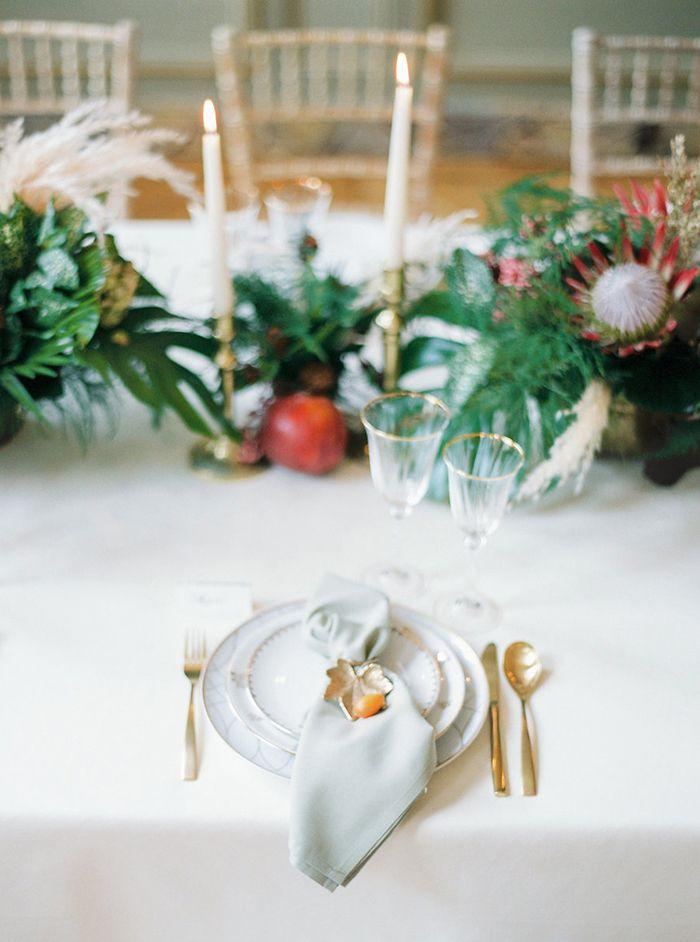 Tropical Greenery Centerpiece with Gold Decor  https://heyweddinglady.com/tropical-greenery-elegance-of-paris/      #wedding #weddings #weddinginspiration #paris #tropical #greenery #weddingreception #weddingdecor