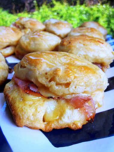 1 can Grands Jr Butter Tasting Biscuits (10 count) 1/2 lb deli ham, shaved 1 cup shredded swiss cheese 1/4 cup honey mustard dressing 1 Tbsp...
